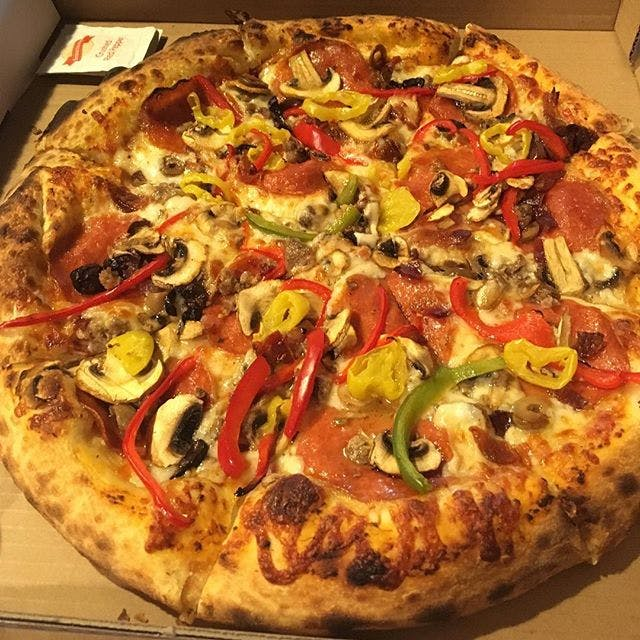 Pizza with anchovies, colored peppers