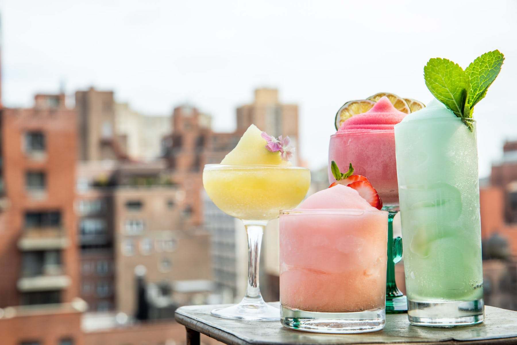 Close up of frozen cocktails while looking at the New York Skyline