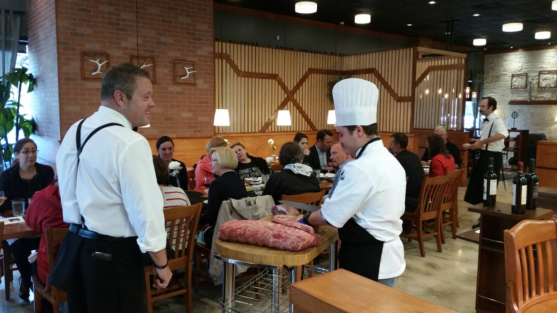 chef entertains customers in castle hills