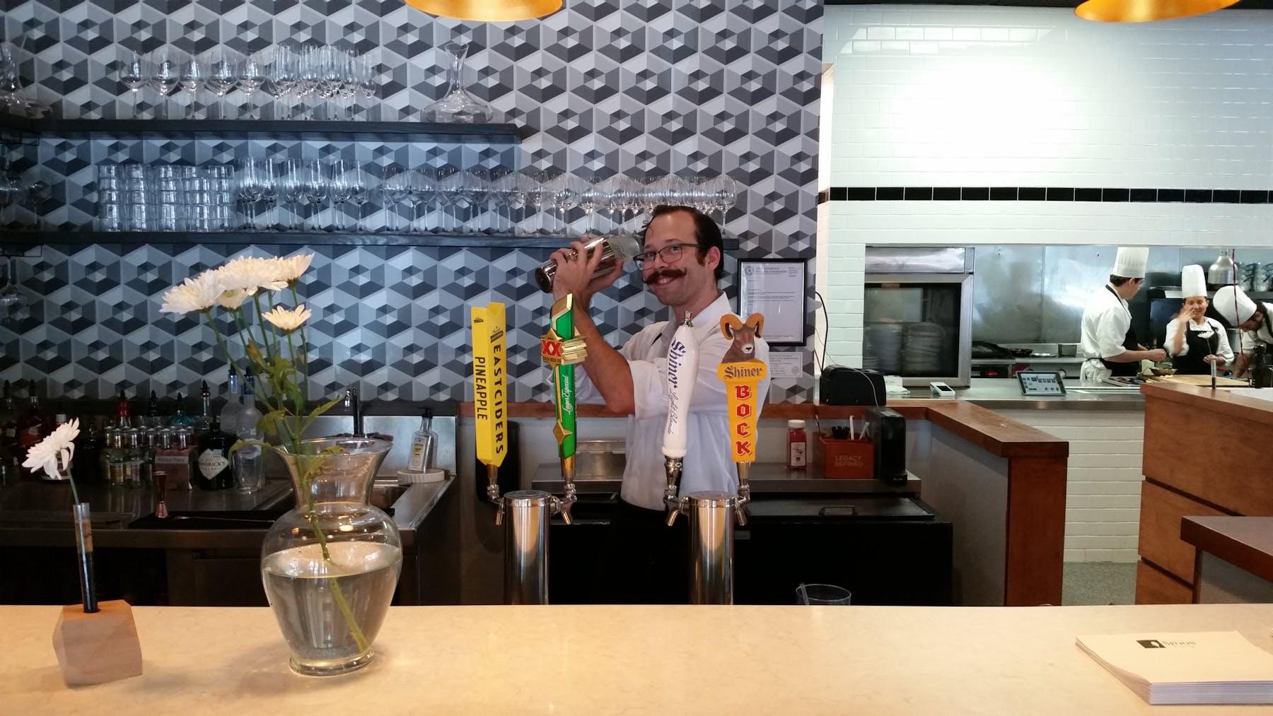 bartender preps drink