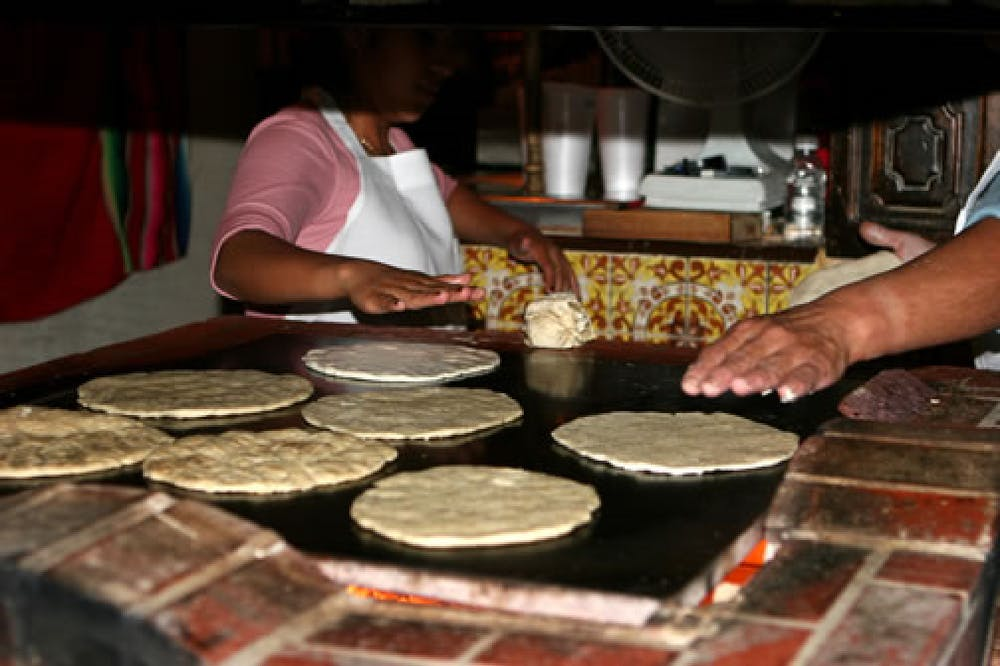 Tortillas being made at the tortilla grill