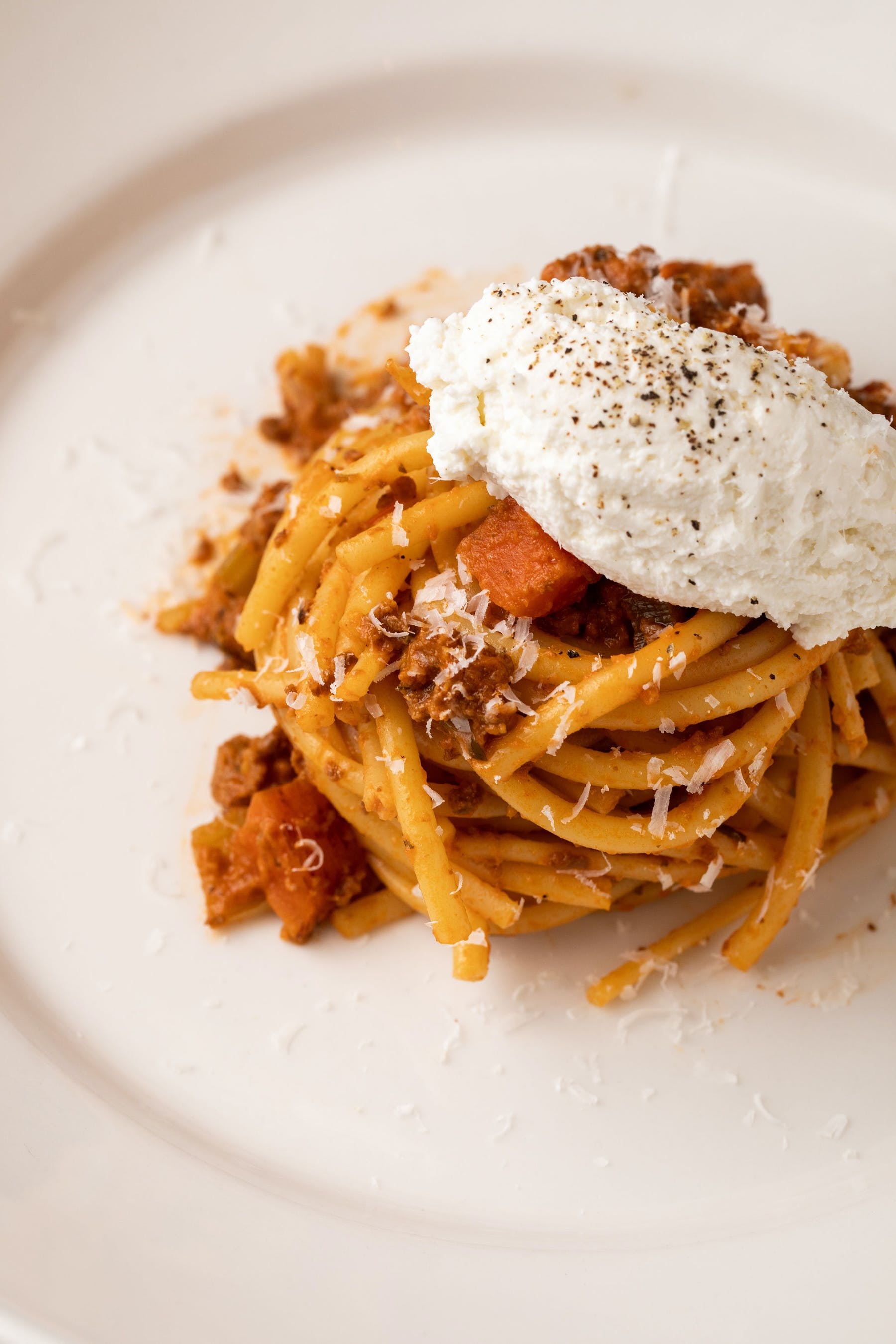 a white plate topped with pasta