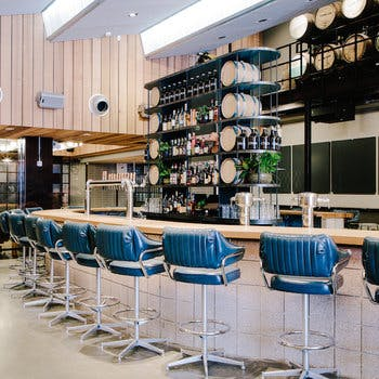 a bar with chairs