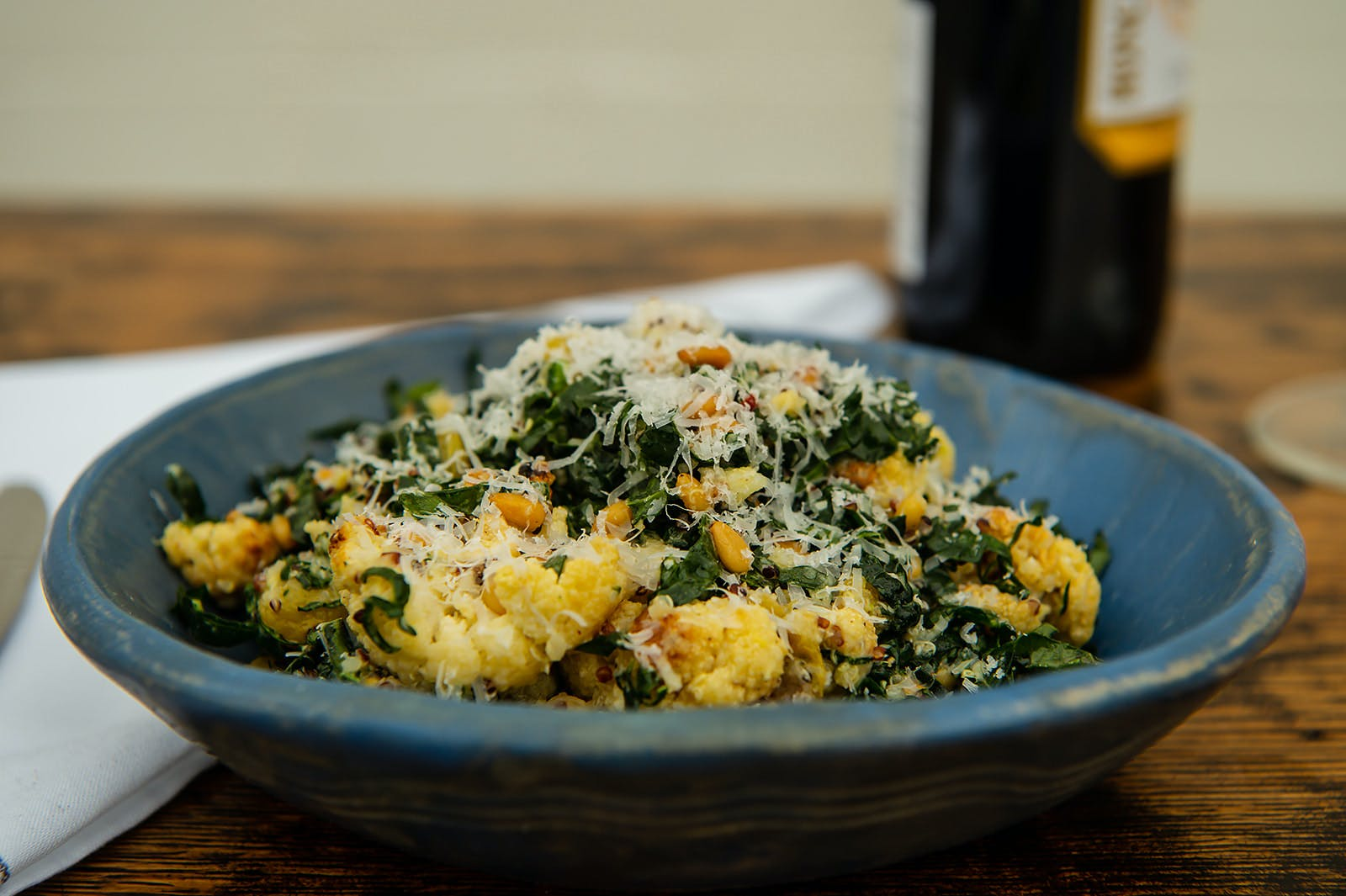 Pasta with grated cheese and greens