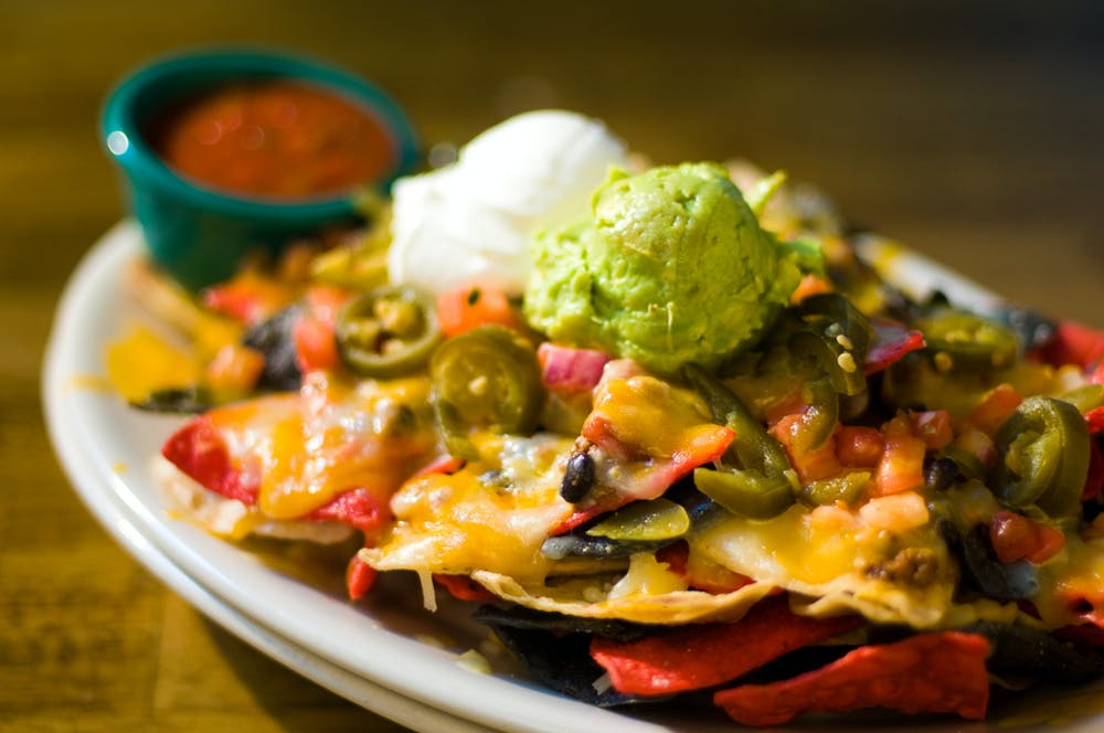 nachos with guacamole and cheese