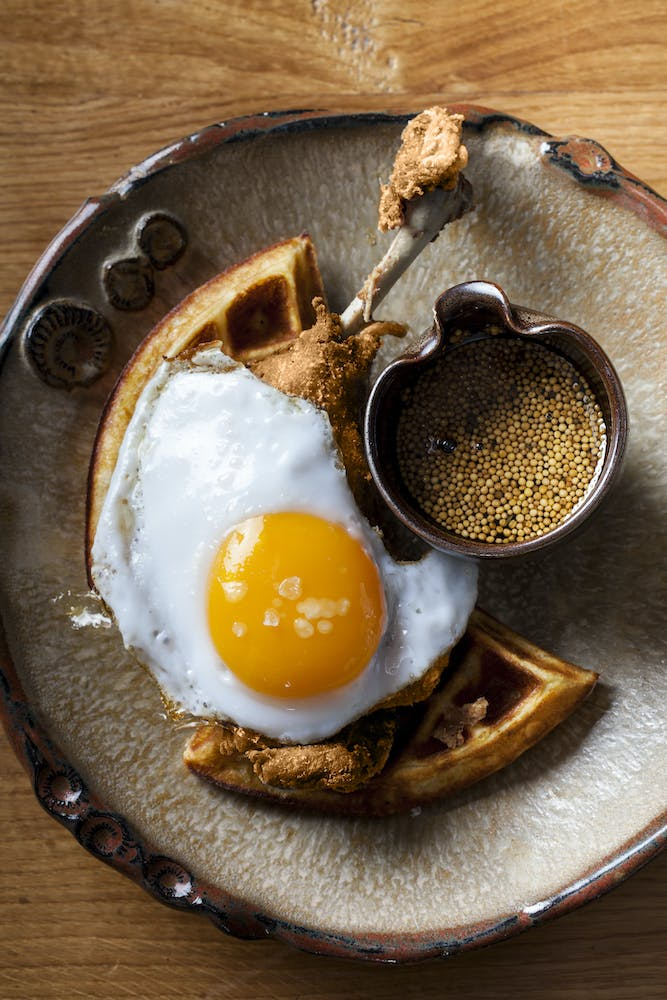 an egg on top of a wooden table
