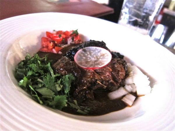 Hugo's beef cheek in pasilla chile sauce is a dream
