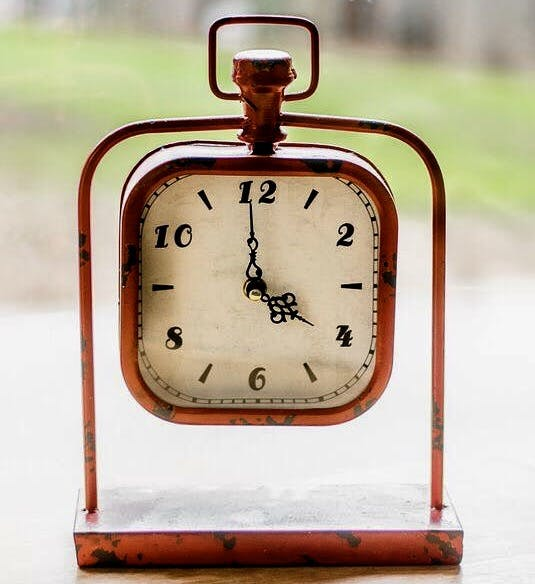 a clock that is on a metal object