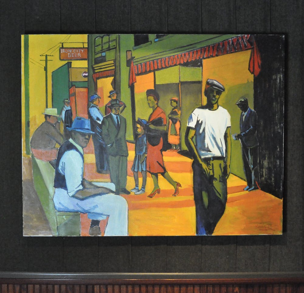 a group of people standing next to a painting