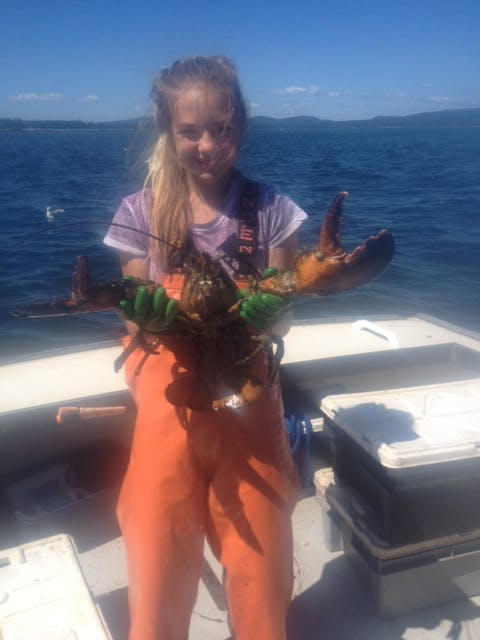 A young Bea holding a Lobster