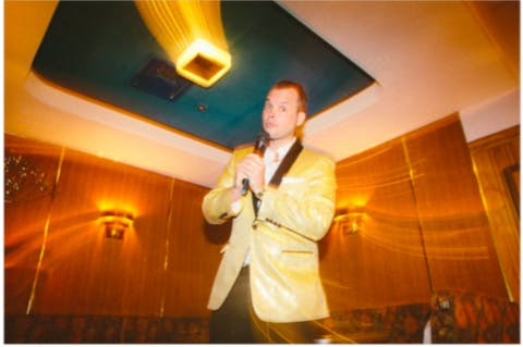 Yellow suit man with a microphone